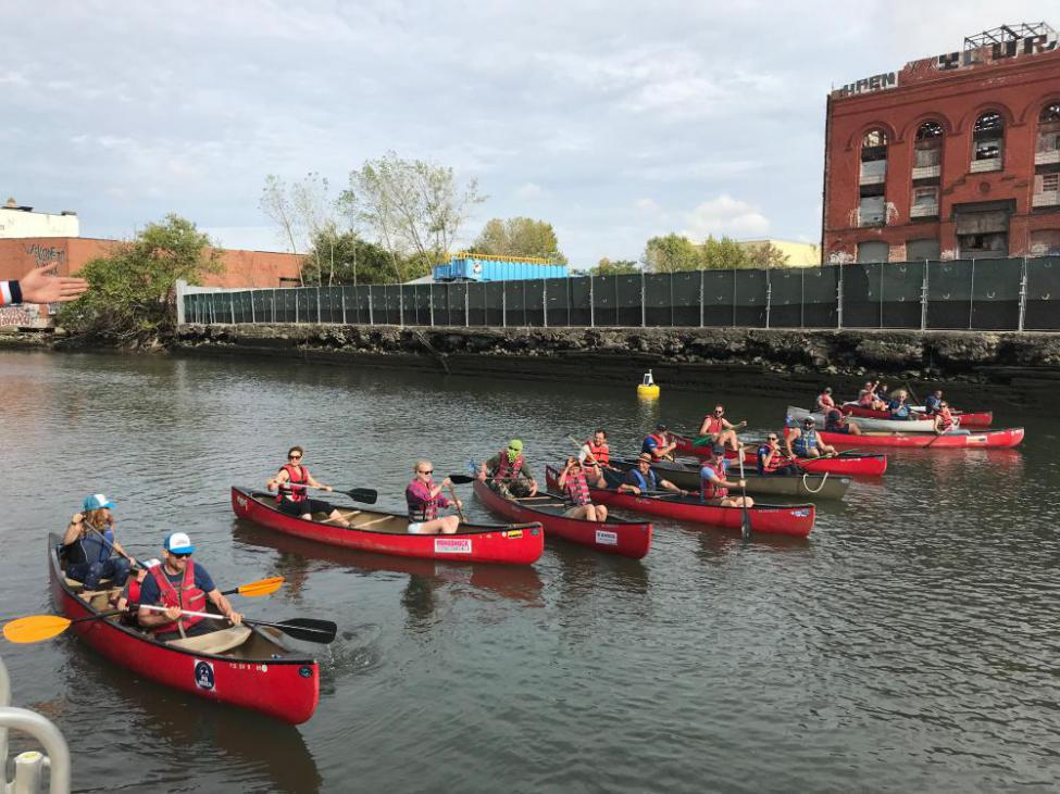 Participants in Canoes Wait for Starter Pistol