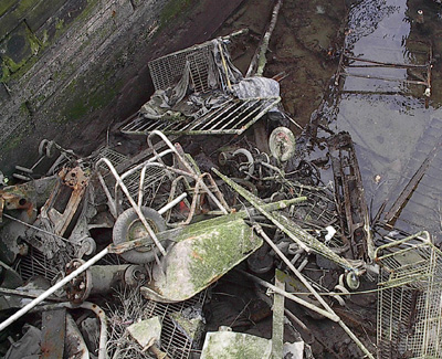 Trash in Canal Prior to Dredgers Cleaning Event